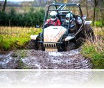 Our buggy Simon driving through a big muddy puddle.